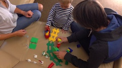 Caucasian family playing with construction set together. Partents and their Stock Footage
