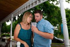 Young Caucasian couple flirt with one another, drink alcohol, and act silly.. Stock Photos