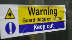 4K Guard Dog warning sticker Stock Footage
