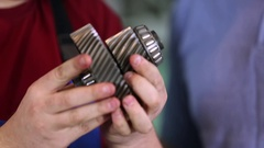 Auto parts in the hands mechanics Stock Footage