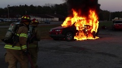 Motor Vehicle Fire fully involved Stock Footage