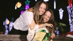 Gracious Lovely Twin Sister Making Surprise Giving Christmas Gift And Hugging Stock Footage