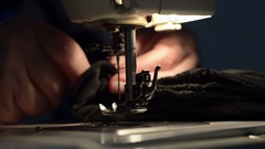 Woman using sewing machine. Stock Footage