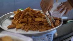 Asian street food, selling deep fried bananas on streets of Bangkok Stock Footage