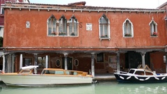 Venice water taxi with ancient building. Stock Footage