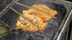 Asian street food, Chiken meat on barbeque grill smoke, soft focus shot Stock Footage
