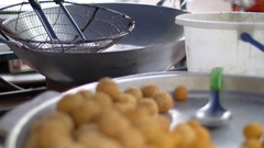 Asian street food, Fresh food deep fried in a pan, at a market Stock Footage