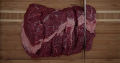 Cutting knife cooled juicy piece of meat into several pieces. Stock Footage