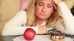 Difficult choice between healthy or junk food, diet concept 4 Stock Footage