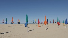 DEAUVILLE, FRANCE - beach with colorful parasols Stock Footage