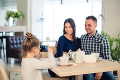 Family, parenthood, technology people concept - close up of happy mother, father Stock Photos