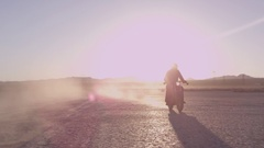 Cafe Racer races across the desert Stock Footage