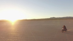 Motorcycle ride through the desert Stock Footage
