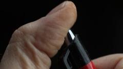 Close up - nervous man clicking pen Stock Footage
