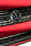 Berlin, Germany - December 5, 2016: Volkswagen company emblem on red car Stock Photos