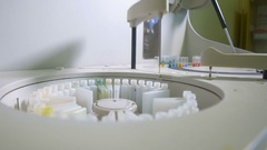 Pharmaceutical Equipment. Automatic robotic medical machine working at a Stock Footage
