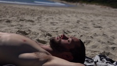 Australia, Byron bay, Young Man Relax on the Beach, Lying on sea towel Stock Footage