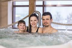 Family relax in a bath Kuvituskuvat