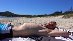 Australia, Byron bay, Young Man Relax on the Beach, Smile at Camera Stock Footage