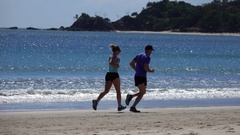 Australia, Byron Bay, Couple Running on the beach, Slow Motion Stock Footage