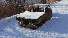 Burned car after a fire happened in winter park. Stock Footage