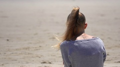 Australia, Byron Bay, Attractive Young Girl Sit on the Beach, Look at Ocean Stock Footage