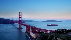 Container ship travels under Golden Gate bridge by mountains 6 Stock Footage