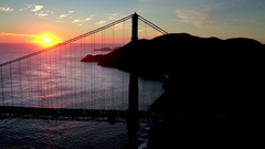 Aerial view of sunset behind San Francisco Bridge over water 3 Stock Footage