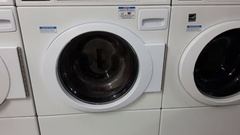 Laundry room with rows of industrial dryer machines Stock Footage