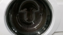 Washing machine with rotating garments inside Stock Footage
