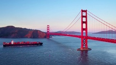 Container ship travels under Golden Gate bridge by mountains 4 Stock Footage