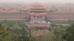 Panoramic view iconic Forbidden City in heavy fog smog Beijing traffic street Stock Footage