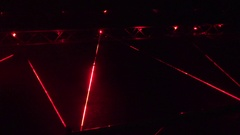 People walk red laser beams at security alarm system demonstration at night. 4K Stock Footage