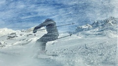 Skier in a snow storm with frozen motion in high dynamic range footage Stock Footage
