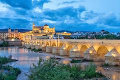 Puente Romano bridge and Mosque-Cathedral of Cordoba Stock Photos