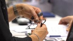 Seller demonstrates new dental loupes lens high resolution. Stock Footage