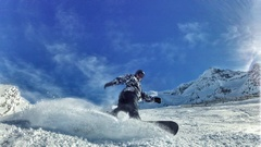Snowboarder hitting slops on a sunny day captured in surreal footage Stock Footage