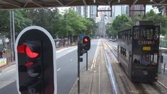 POV Point of view tramway wait at stop traffic light Hong Kong crowded downtown Stock Footage