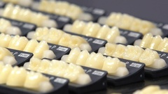 Many samples of dental crowns on the stand. Stock Footage
