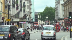 Traffic car on busy street London commercial avenue local red box telephone icon Stock Footage
