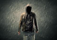 Spooky faceless guy standing in hoodie Stock Photos