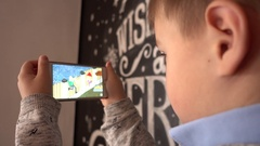 Little Boy Watch Cartoon Via Smart Phone Display Stock Footage
