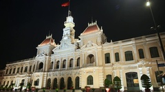 Night Traffic in front of the City Hall in Ho Chi Minh City Saigon , Vietnam Stock Footage