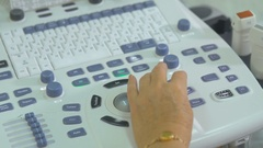 Female unrecognizable doctor operating ultrasonic, ultrasound test unit Stock Footage