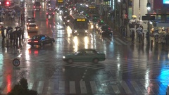 Traffic car in heavy rain fall by night Tokyo crowded downtown road bad weather  Stock Footage