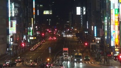 Aerial view busy traffic car by night Tokyo crowded downtown neon sign landmark Stock Footage