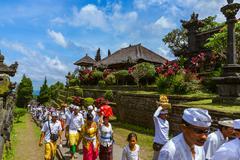 BALI INDONESIA - APRIL 26: Prayers in Pura Besakih Temple on April 26, 2016.. Stock Photos