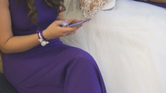 Bride and girlfriend sit at registration hall Stock Footage