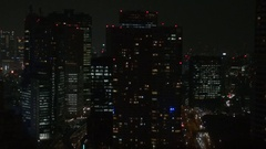 Tall modern skyscraper by night crowded Tokyo business area building tower icon Stock Footage
