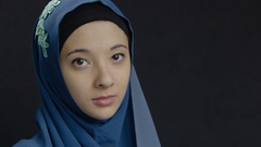Portrait of a young woman wearing a hijab Stock Footage